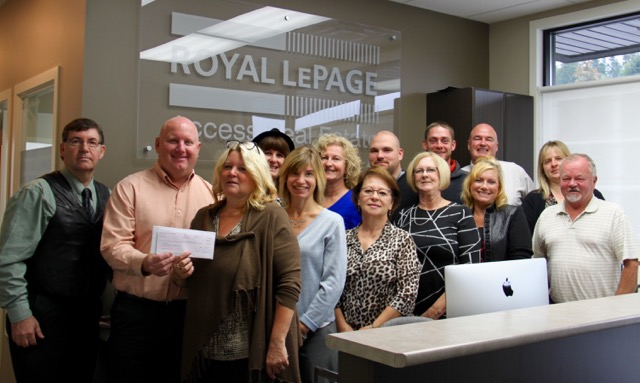SAFE Society accepts cheque from Royal LePage Access agents and staff